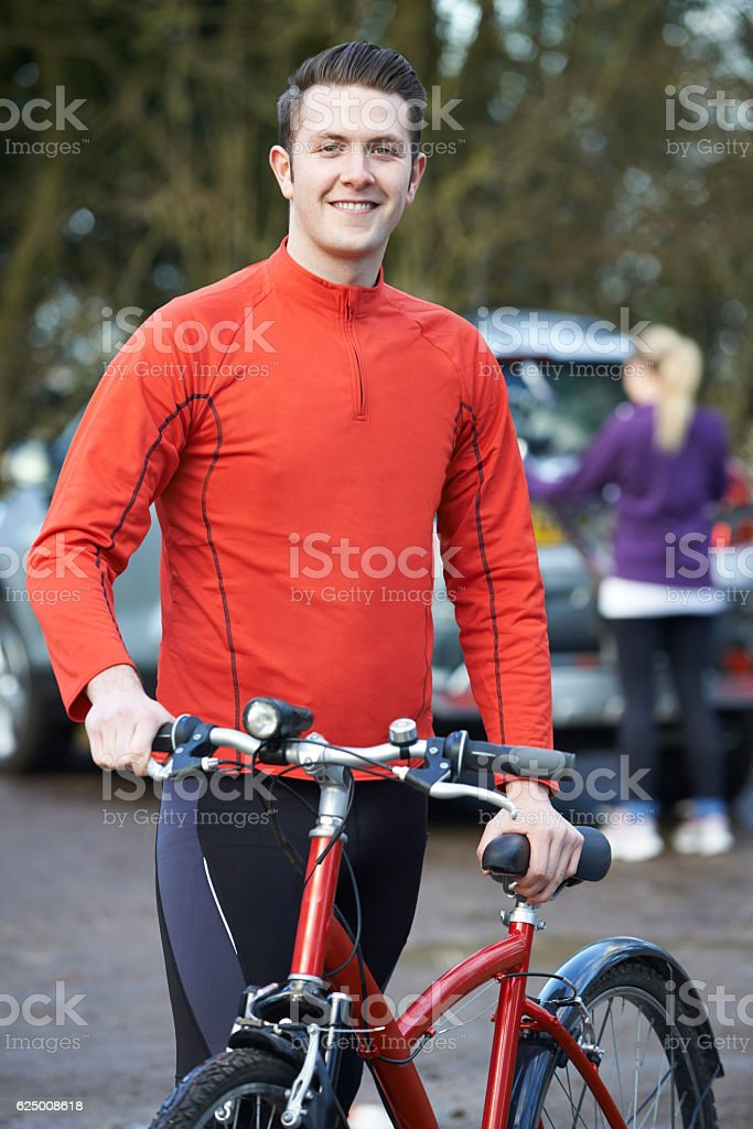 Couple Cycling Taking Mountain Bikes From Rack On Car stock photo