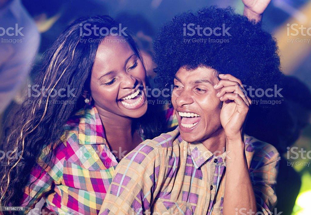 Couple dacing at a nightclub stock photo