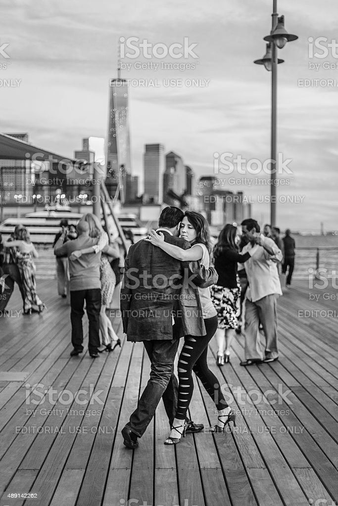 Couple dance tango on a River Hudson pier, NY stock photo
