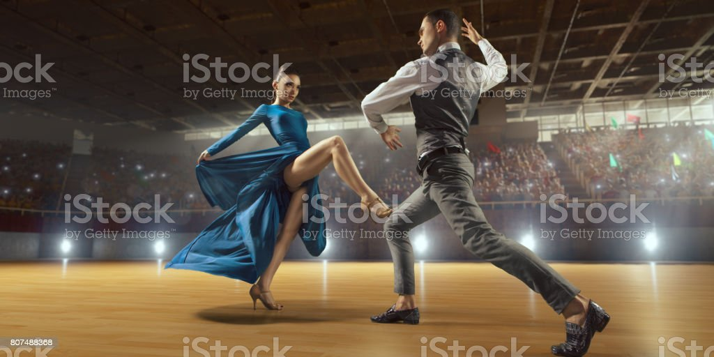 Couple dancers ardently perform the latin american dance on a large professional stage stock photo