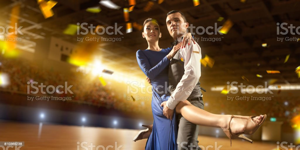 Couple dancers ardently perform the latin american dance on a large professional stage with sparkle fireworks stock photo