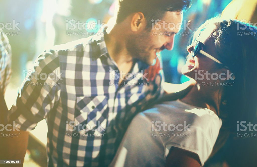 Couple dancing at a party. stock photo