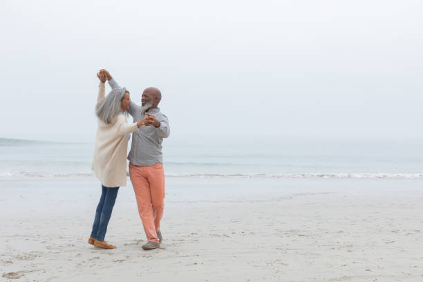 Couple dancing at the beach stock photo
