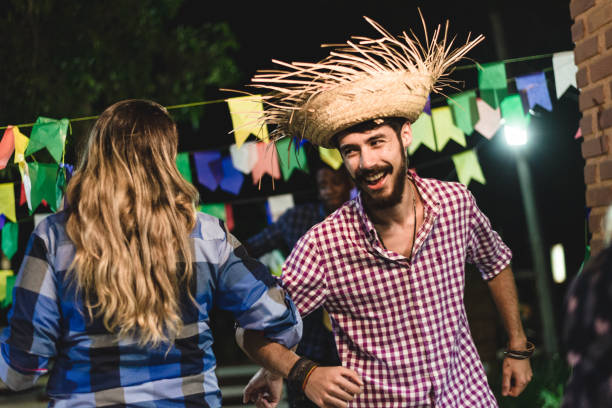 Couple dancing at the junin party stock photo