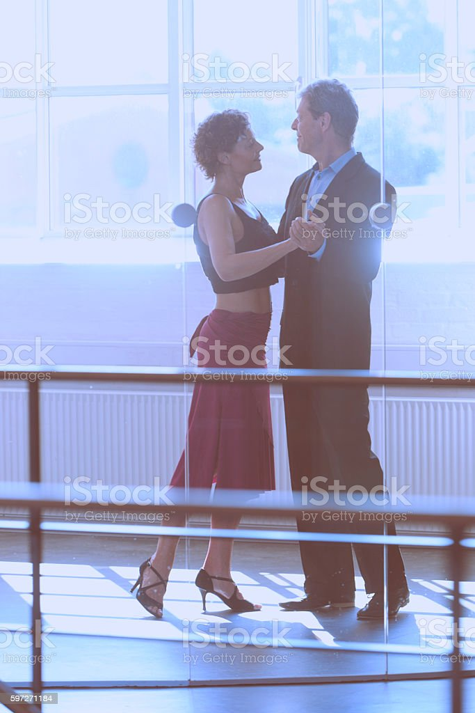 Couple dancing in front of big window royalty-free stock photo