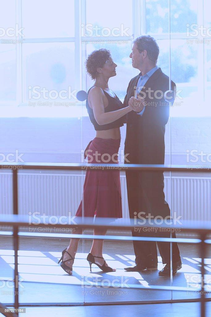 Couple dancing in front of big window Lizenzfreies stock-foto
