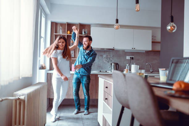 Couple Dancing In Kitchen stock photo