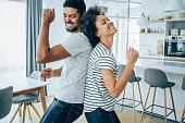 istock Couple dancing in living room. 1285783760