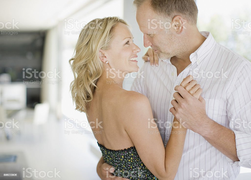 Couple dancing in living room royalty-free stock photo