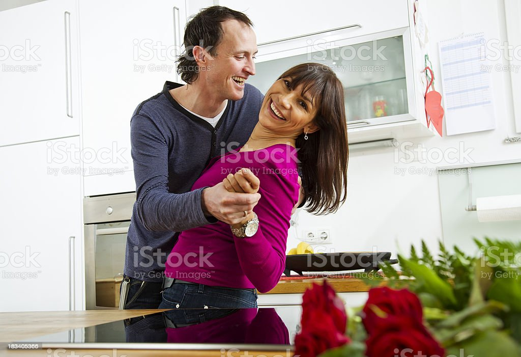 Couple Dancing in the Kitchen royalty-free stock photo