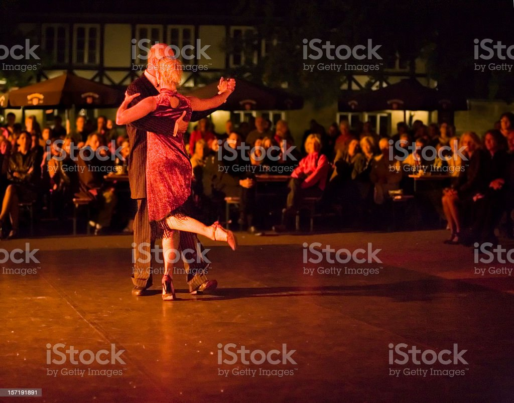 A couple dancing in the open air of Milonga at night stock photo
