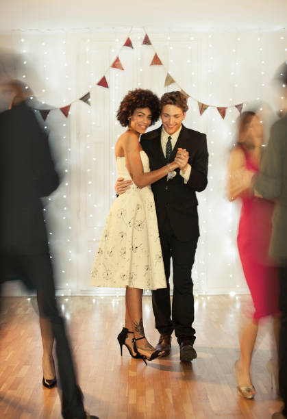 Couple dancing on dance floor Couple dancing on dance floor prom night stock pictures, royalty-free photos & images