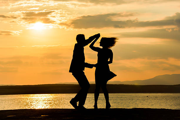 couple dancing salsa at sunset - tipo di danza foto e immagini stock