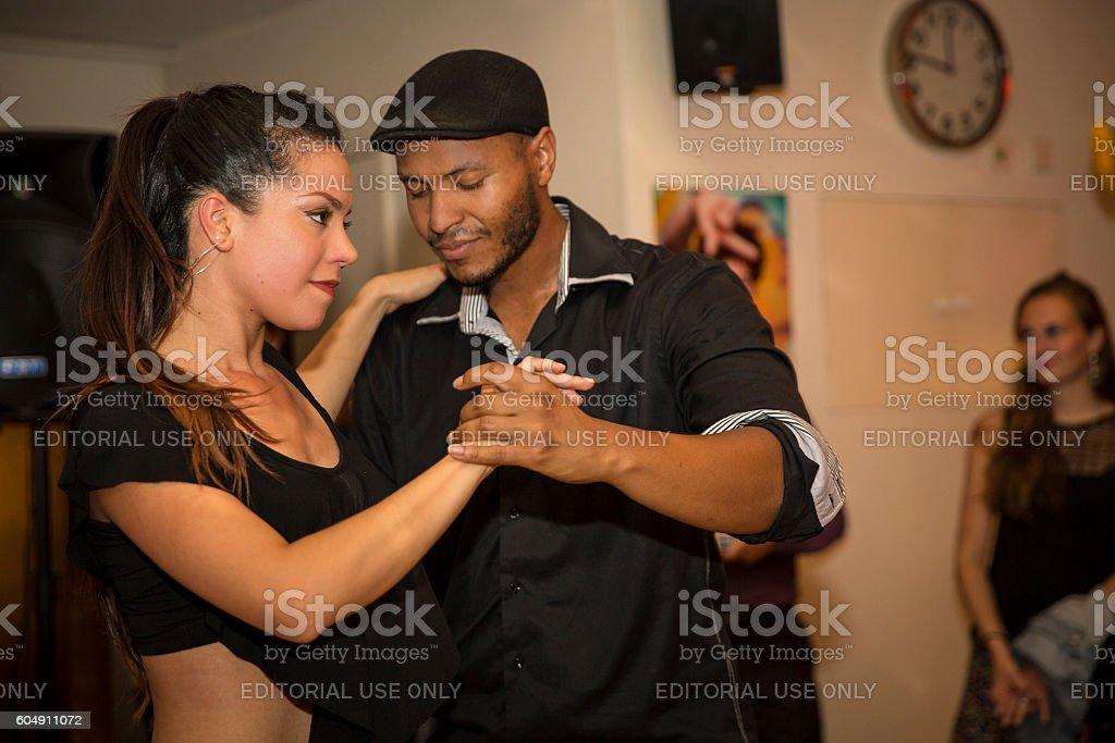 couple dancing salsa at World Cinema Amsterdam festival closing party stock photo