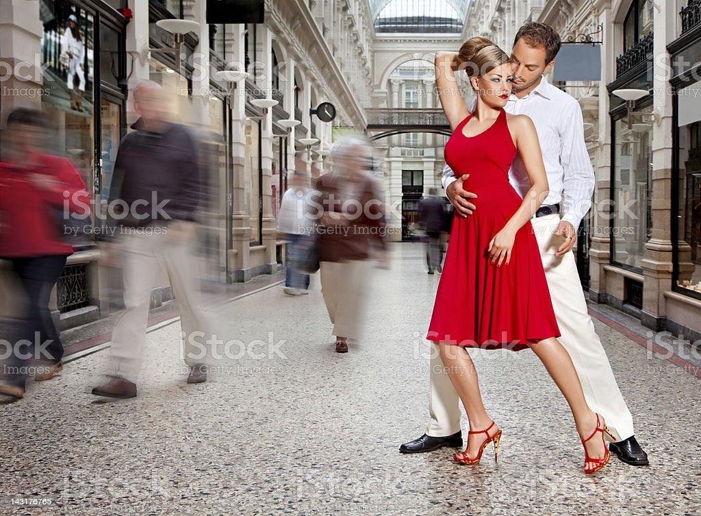 couple dancing tango at city street couple dancing tango at city street Adult Stock Photo