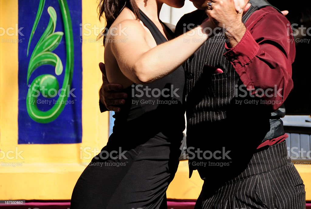 Couple dancing tango in Caminito, La Boca, Buenos Aires, Argentina stock photo