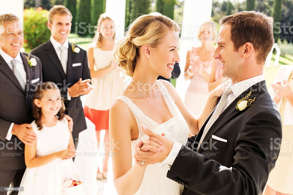 Couple Dancing With Guests Clapping In Background stock photo