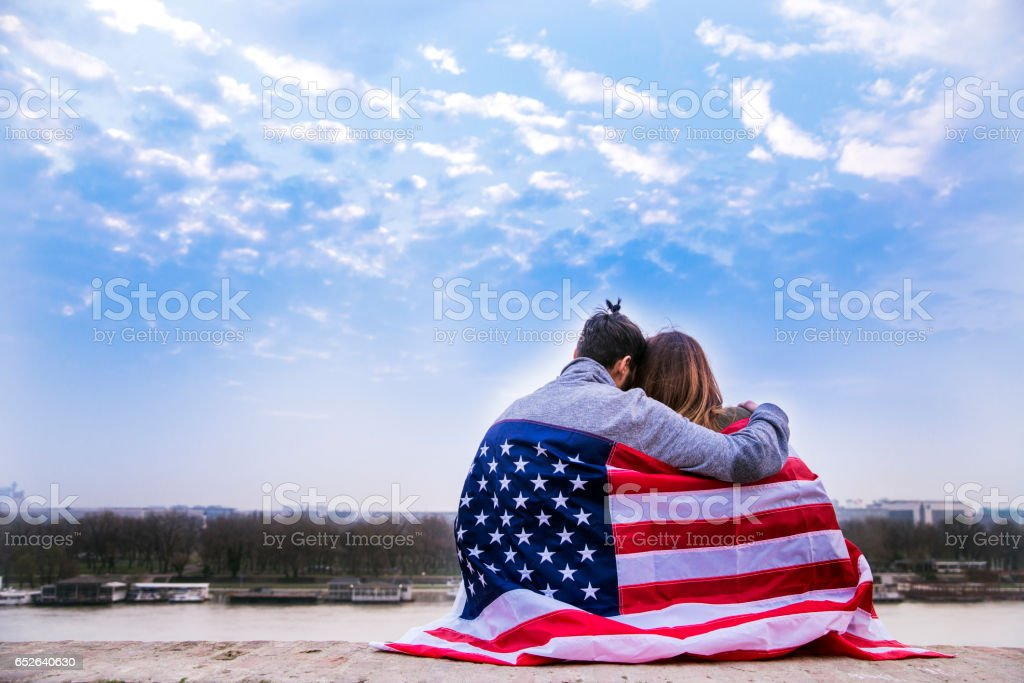 Couple Dates with American flag stock photo