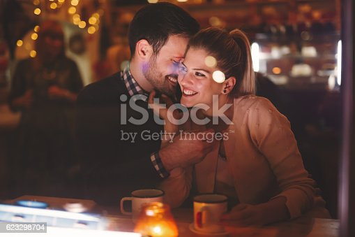 istock Couple dating at night in pub 623298704