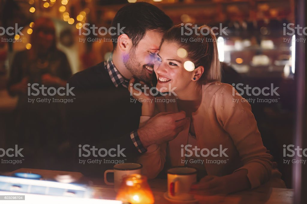 Couple dating at night in pub stock photo