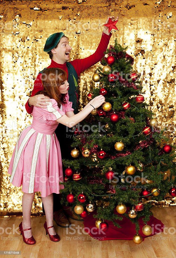 Couple Decorating a Christmas Tree stock photo