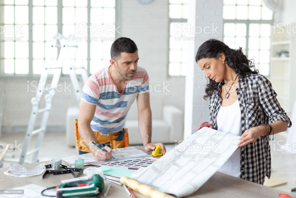 Couple decorating new home royalty-free stock photo