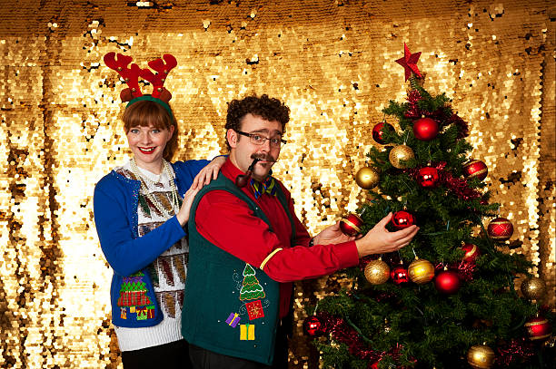couple decorating - ugly sweater stock photos and pictures