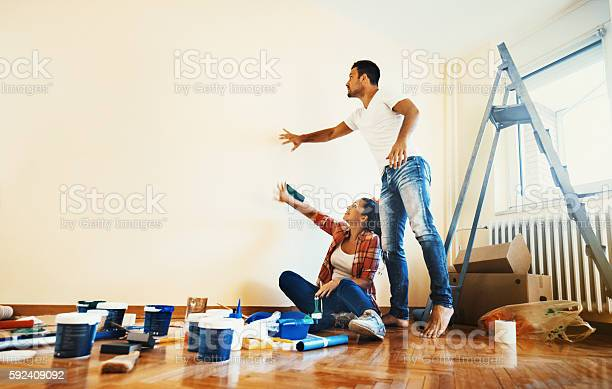 Couple Decoration Their Apartment Stock Photo - Download Image Now