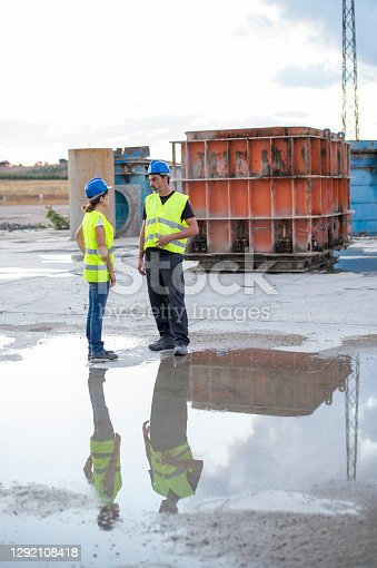 Couple discuss and talk after a day of work outside a construction company