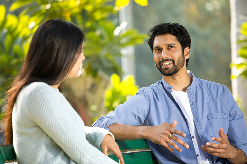 Indian couple talking and spending leisure time at park