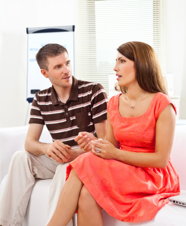 Couple Discussing At Work Stock Photo - Download Image Now