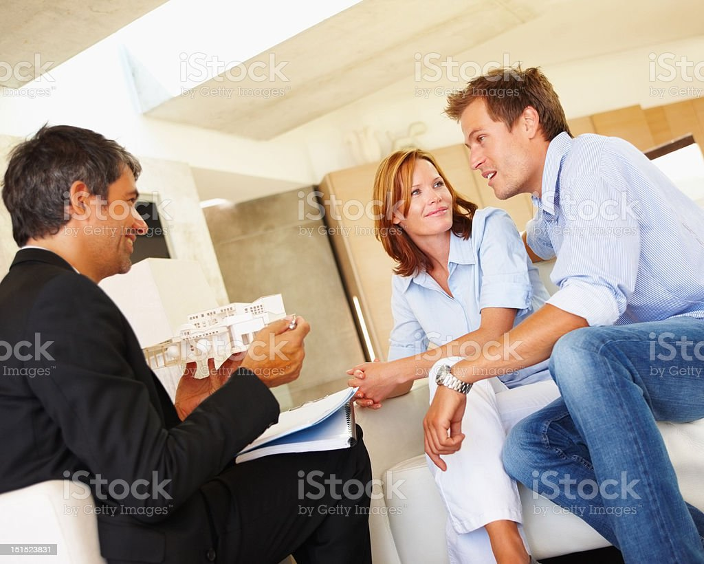 Couple discussing financial matter with consultant royalty-free stock photo
