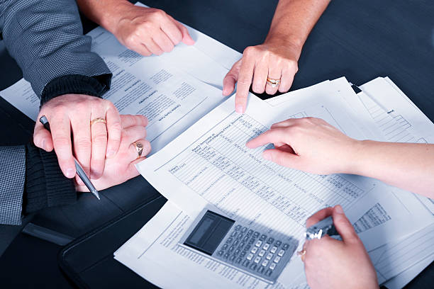Couple discussing financial matters with advisor stock photo
