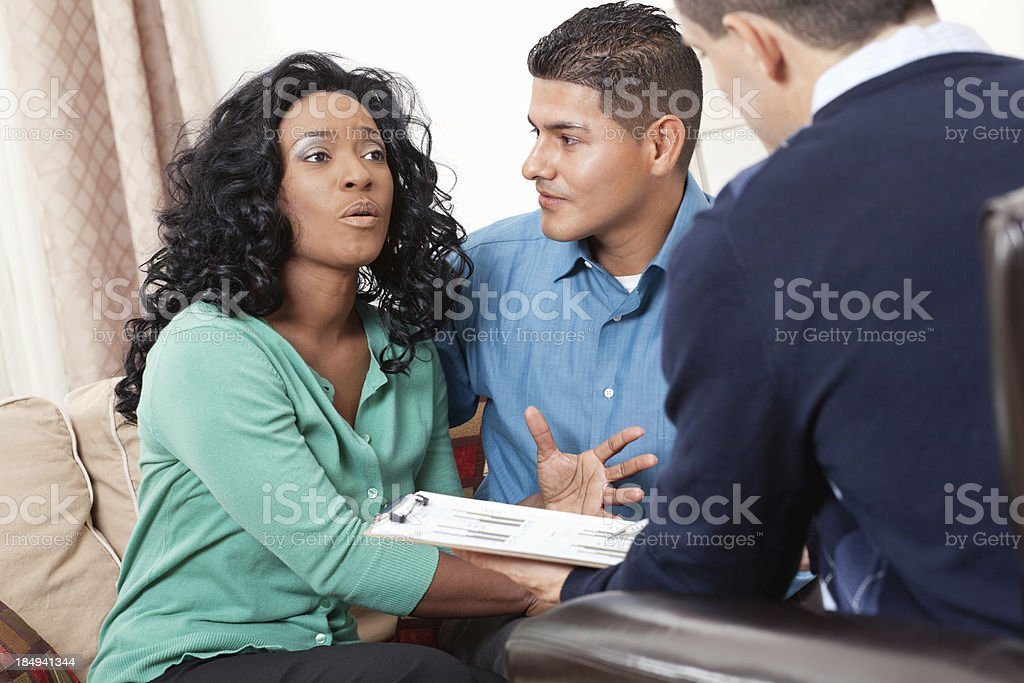 Couple discussing financial situation with their advisor royalty-free stock photo