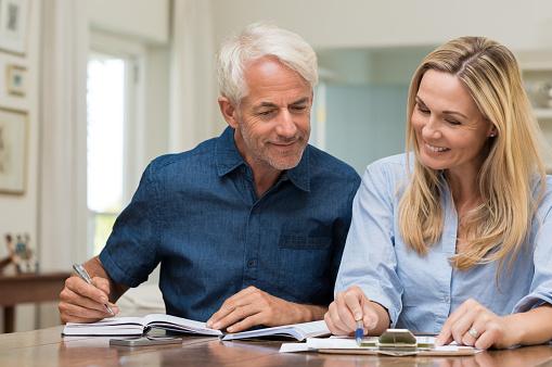 istock Couple discussing home economics 531414568