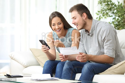 istock Couple doing accounting with a phone bank app 623211350