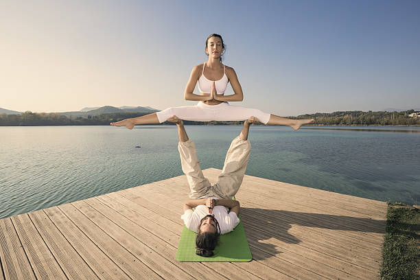 Couple doing acroyoga in nature - Photo