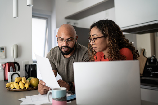 Couple doing home finances together at home
