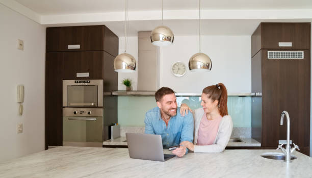 Couple doing online shopping at home stock photo