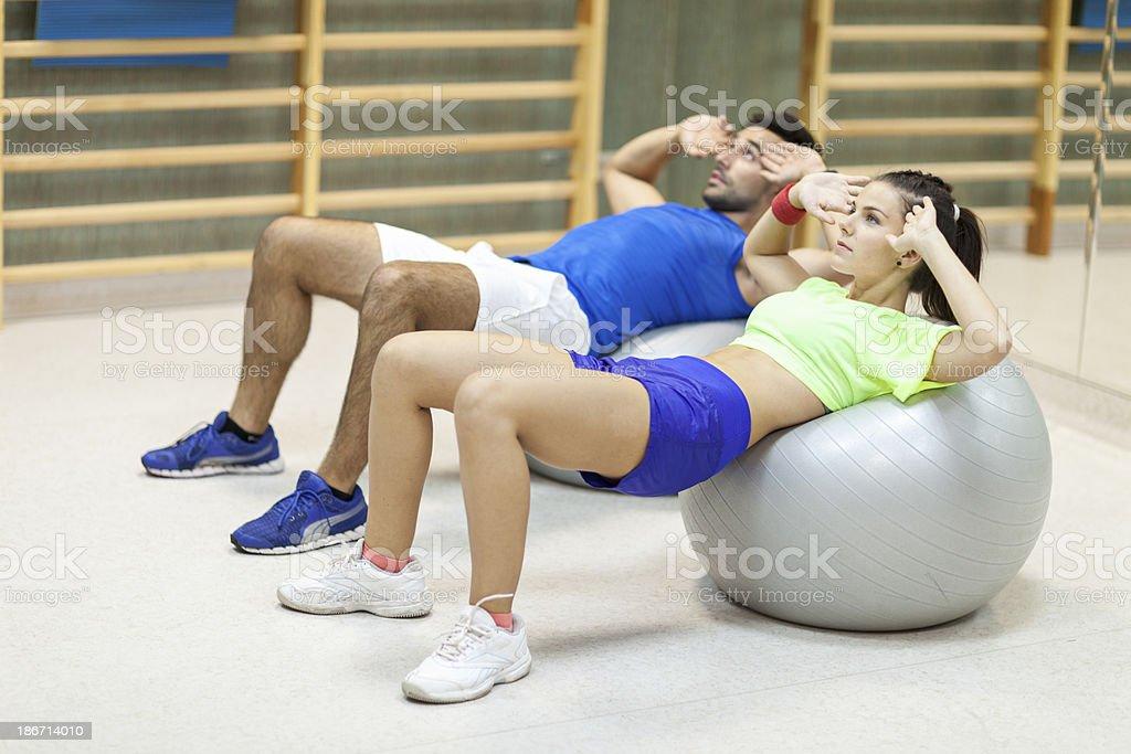 Couple Doing Pilates Exercises royalty-free stock photo