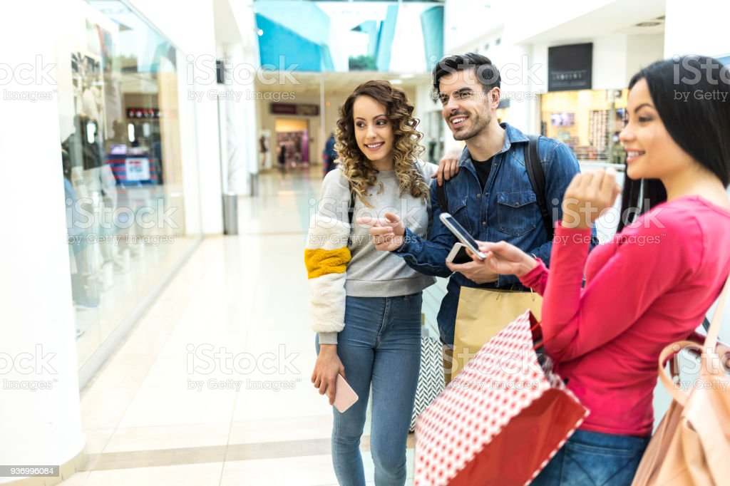 Couple doing shopping in department store stock photo
