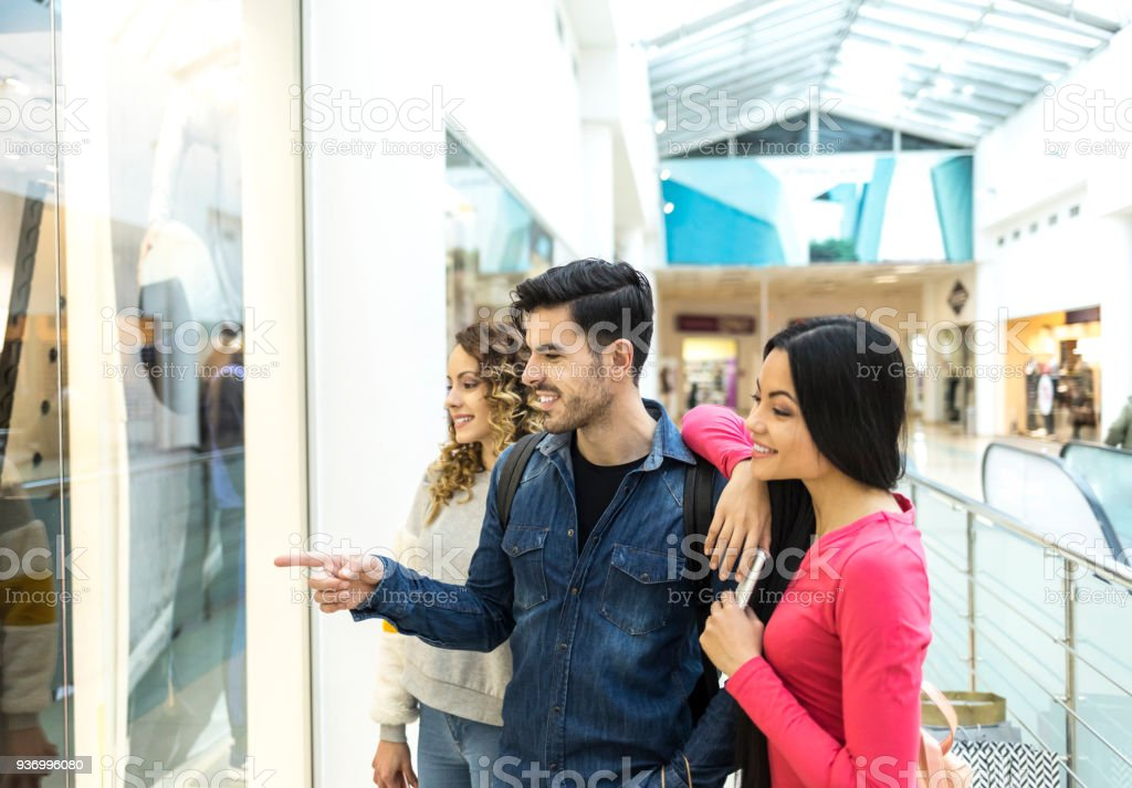 Couple doing shopping in mall stock photo