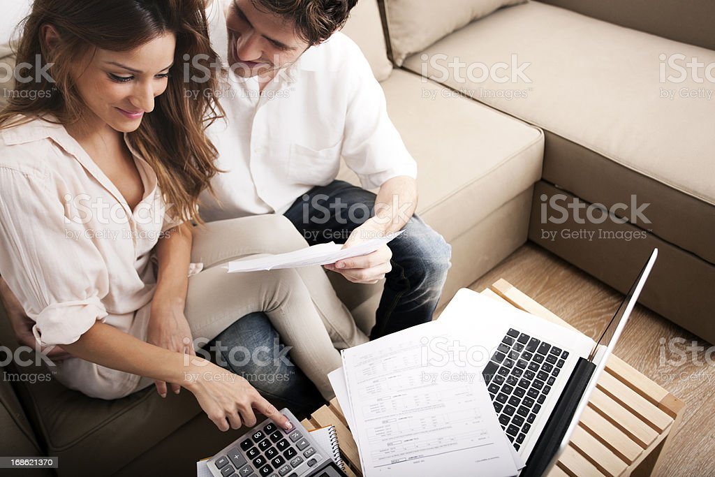 Couple doing their domestic finances in living room. royalty-free stock photo