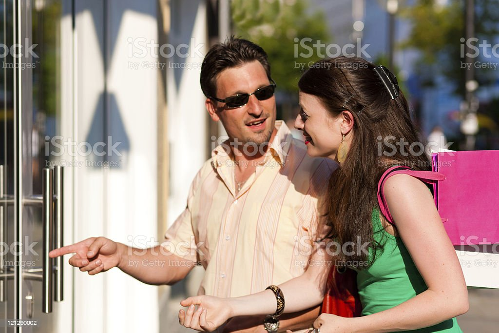Couple downtown shopping with bags royalty-free stock photo