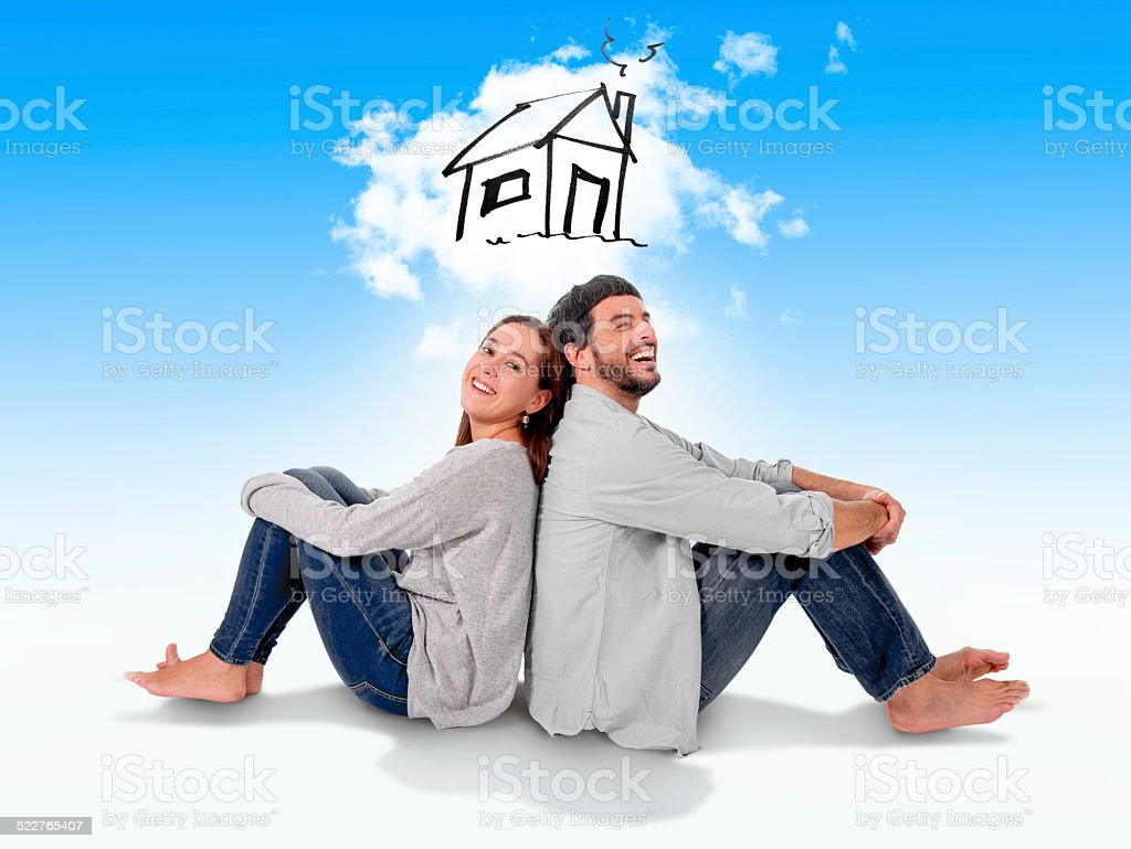 couple dreaming and imaging new house in real state concept stock photo