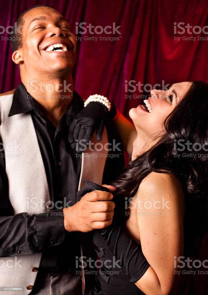 f6d6cb064081 Couple dressed for evening out on dance floor night club. - Stock image .