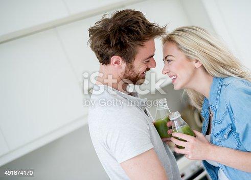 930265372 istock photo Couple drinking a detox juice 491674170
