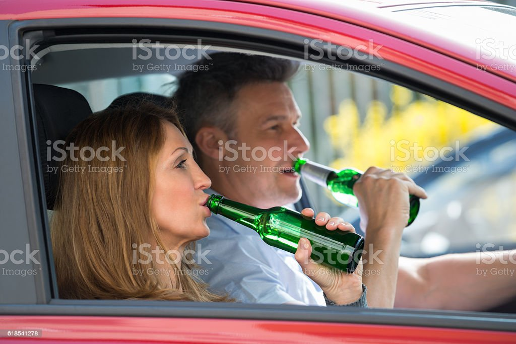 Couple Drinking Alcohol In Car stock photo