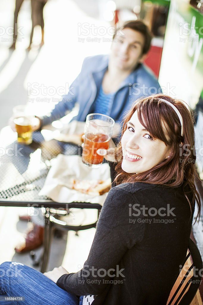 Couple Drinking at Outdoor Pub royalty-free stock photo