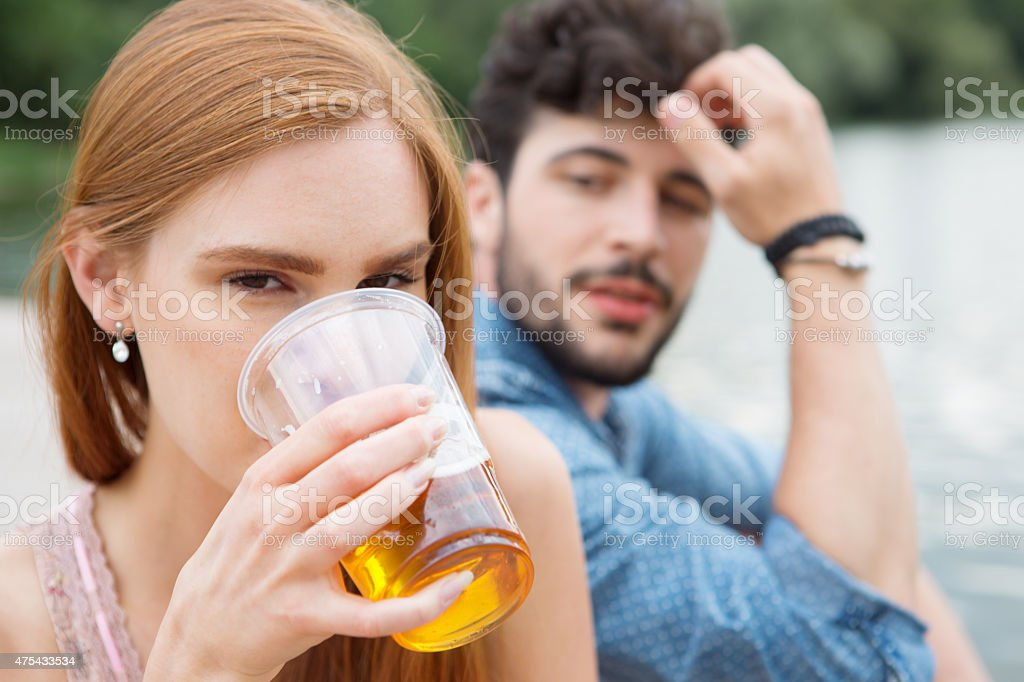 Couple drinking beer in summer Couple drinking beer in summer 2015 Stock Photo